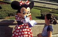 Minnie signing an autograph at the Magic King