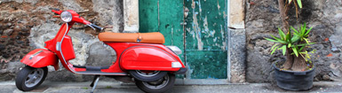 Sicily: the sun on the back of a vespa